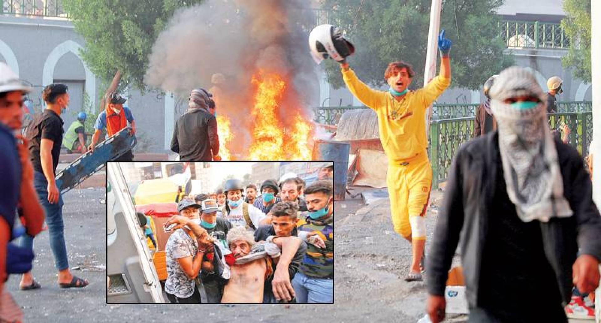 متظاهرون يشعلون النيران خلال مواجهات مع قوات الأمن في بغداد.. وفي الإطار إسعاف جريح | رويترز