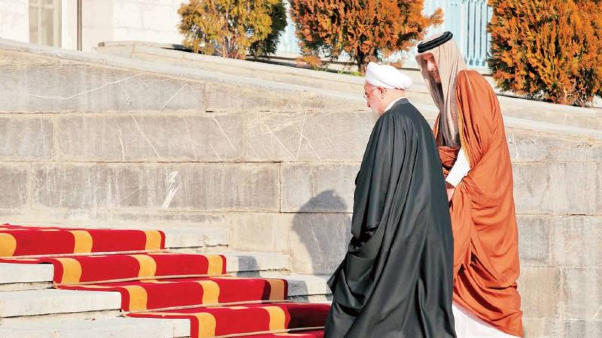 روحاني خلال استقباله تميم بن حمد| أ.ف.ب