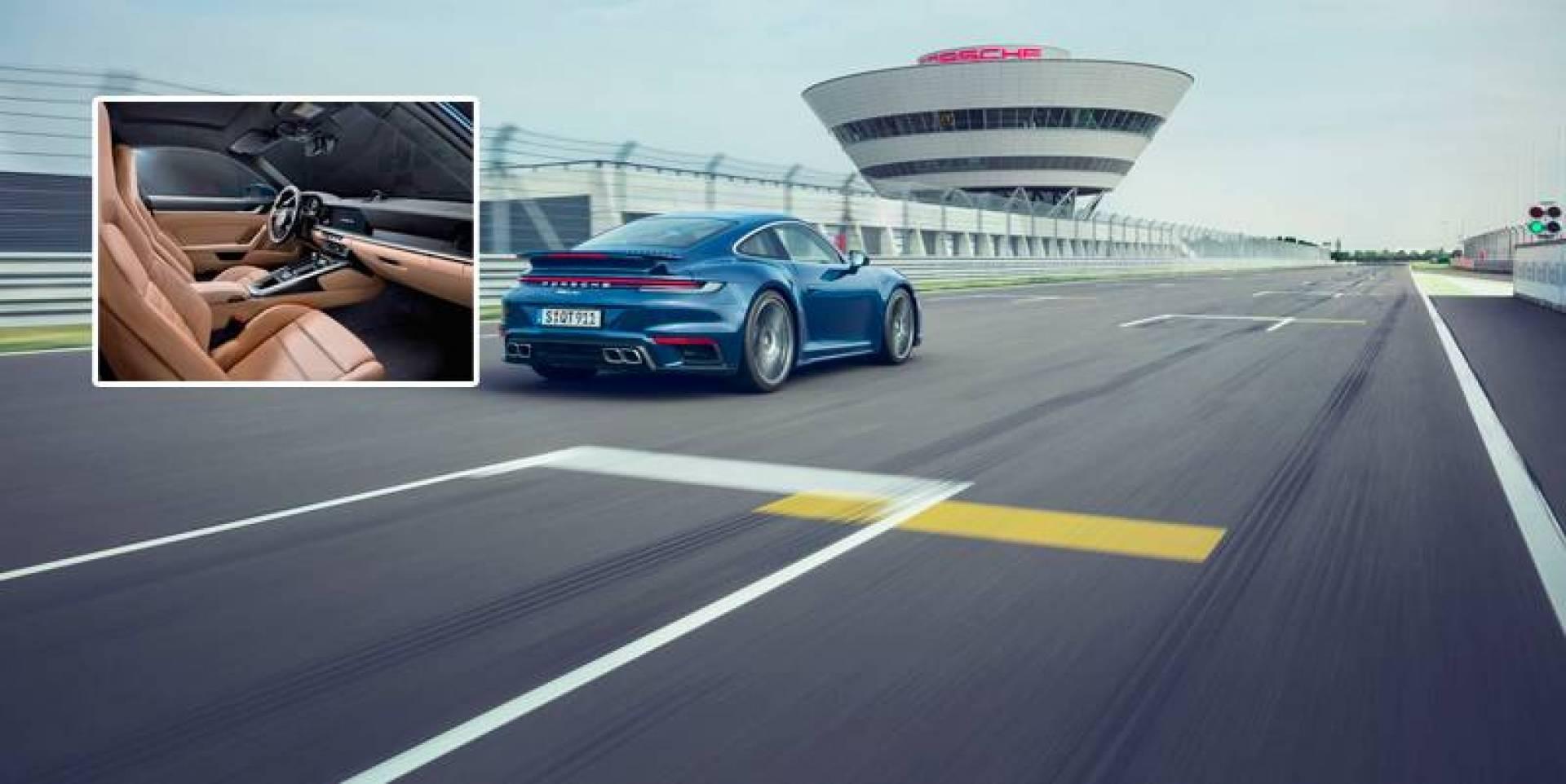 بورشه 911 توربو خلال تجربة قيادة على الحلبة في ألمانيا.. وفي الإطار مقصورة السيارة الفارهة